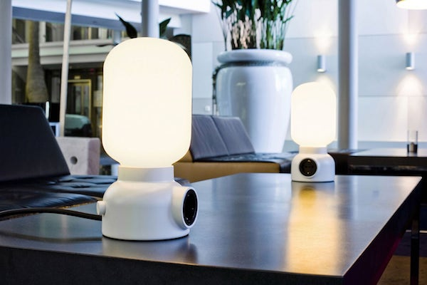 Add two way utility to your space with the ateljé lyktan plug table lamp featuring a camping inspired design this robust lamp illuminates your space