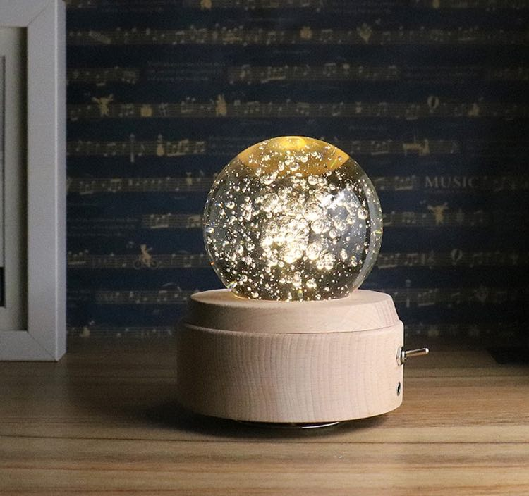 This crystal ball music box adds a great ambience to any room its in the crystal ball reflects a beautiful pattern as it illuminates and rotates
